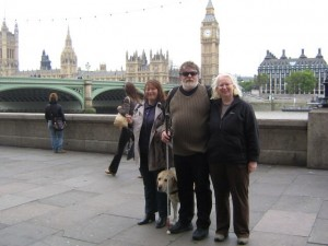 Photo of Erika and Greg with Lee Kumutat with Big Ben