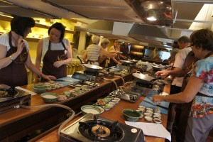 Image of our Tour Group cooking over hot woks