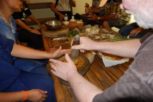 Photo of Greg using mortar and pestle to mix herbs