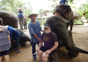 Photo of Greg sitting on Elephant's lap at Maetaman Elephant Camp Chiang Mai