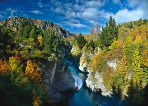The image sshows a stunning view of Canyons towering above the Shotover River