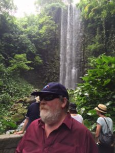 Greg at Jurong Bird Park at a waterfall
