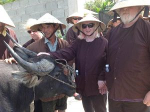 Photo of Erika and Greg with bullock at Rice Farm near HoiAn