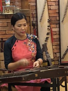 Photo of Musician playing traditional instrument in Ho Chi Minh